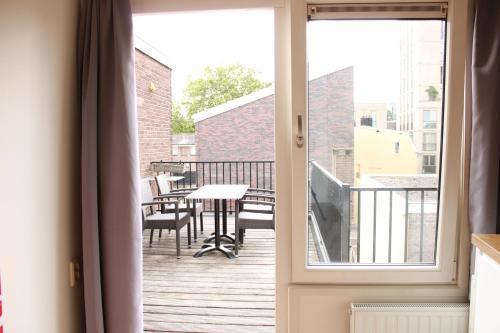 Een balkon of terras bij HOLT Hotel