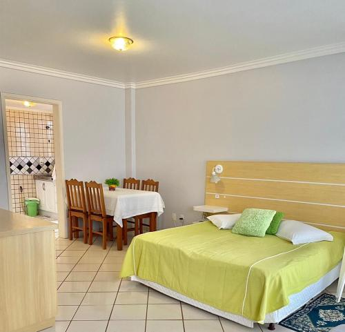 A bed or beds in a room at Residencial Nápole