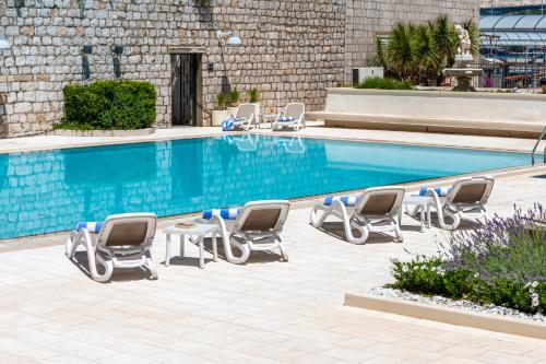 The swimming pool at or near Hotel Lapad