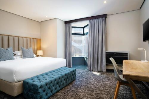 A bed or beds in a room at Premier Splendid Inn Umhlanga