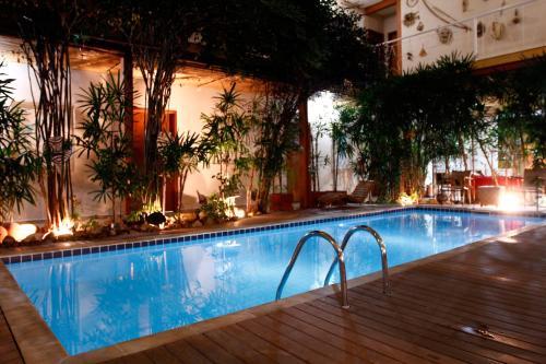 The swimming pool at or near Pousada Ilha Brazil