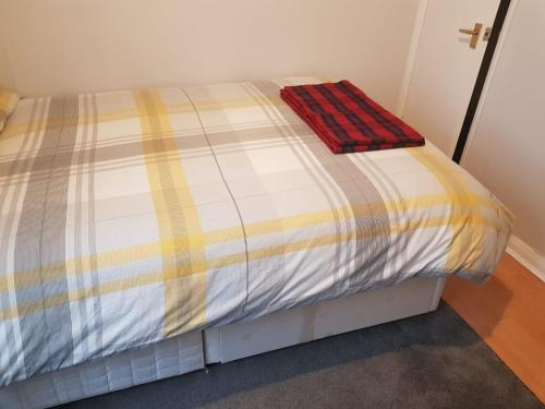 A bed or beds in a room at Beckenham Ravenscroft