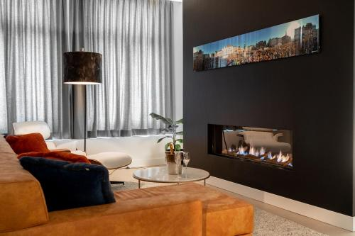 A television and/or entertainment center at Bossche Suites No2 - Verwersstraat