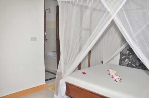A bed or beds in a room at Bagamoyo Spice Villa