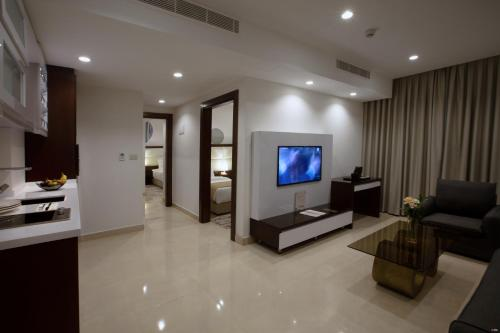 A television and/or entertainment center at Seas Hotel Amman