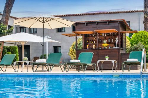 The swimming pool at or near Salles Hotel Aeroport de Girona