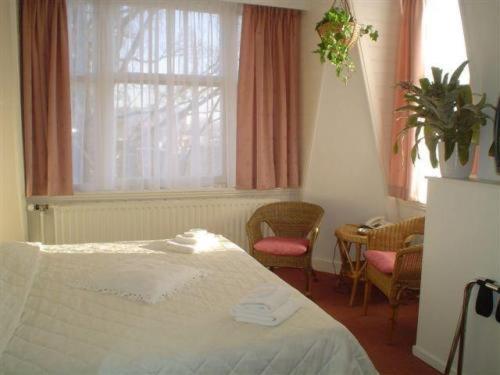 Un ou plusieurs lits dans un hébergement de l'établissement Staten Hotel