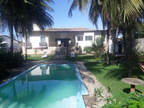 The swimming pool at or close to Sophia So Beliches Hostel