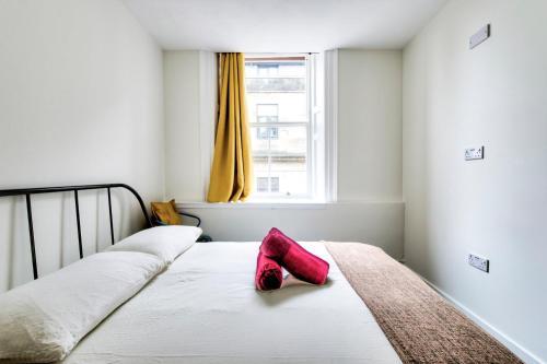 Letto o letti in una camera di Haystack Hostel