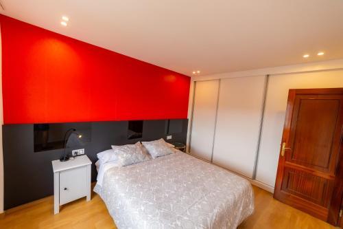A bed or beds in a room at Apartamentos Camino De Finisterre