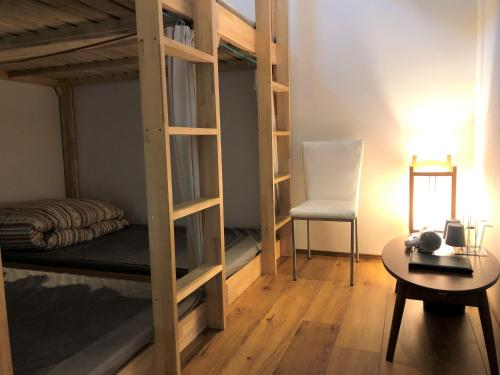 A bunk bed or bunk beds in a room at Kanazawa Guesthouse Stella