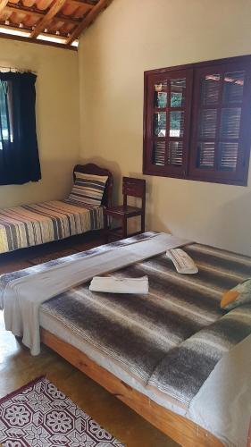 A bed or beds in a room at Hospedagem Brilho da Lua