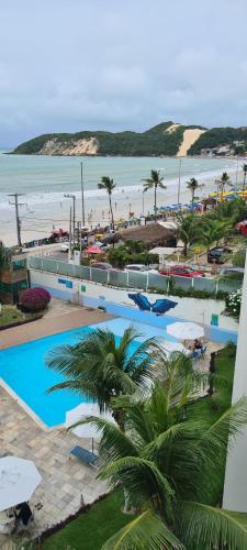 A view of the pool at APTO - HOTEL PONTA NEGRA BEACH RESIDENCe or nearby