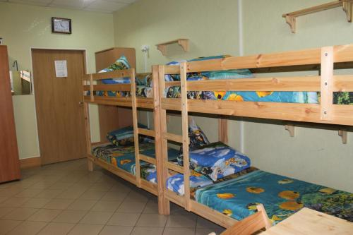 A bunk bed or bunk beds in a room at Siberian Hostel