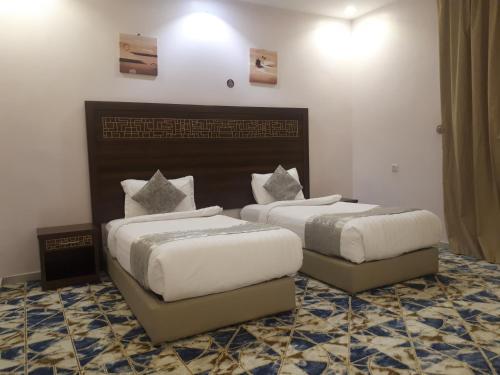 Cama ou camas em um quarto em Noor Grand