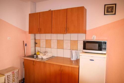 Kuchnia lub aneks kuchenny w obiekcie Przystań