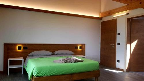 A bed or beds in a room at Camping Canè in Fiore