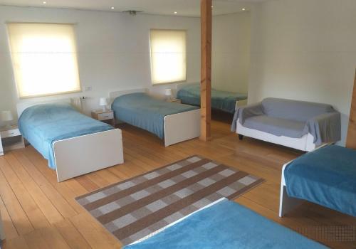 A bed or beds in a room at FloorOne - Geräumige, gemütliche Unterkunft in zentraler Lage