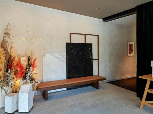 A television and/or entertainment center at L'Esquisse Hotel & Spa Colmar - Mgallery