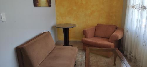 A seating area at Hotel Los Ceibos