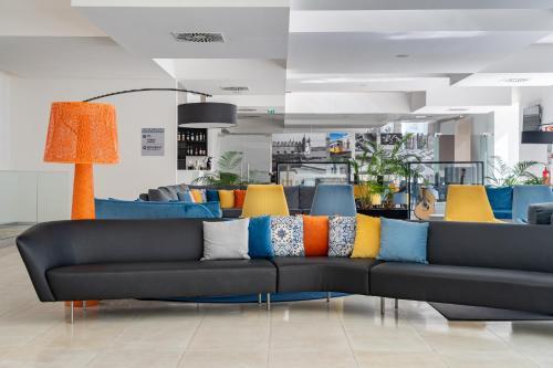 The lobby or reception area at Jupiter Lisboa Hotel