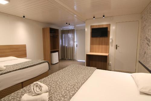 Кровать или кровати в номере Hotel Rio de Pedras