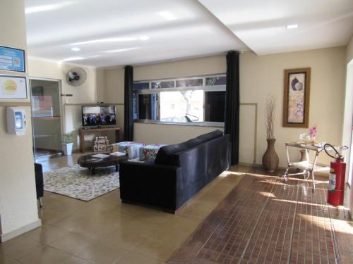 O saguão ou recepção de Hotel E Turismo São Simão