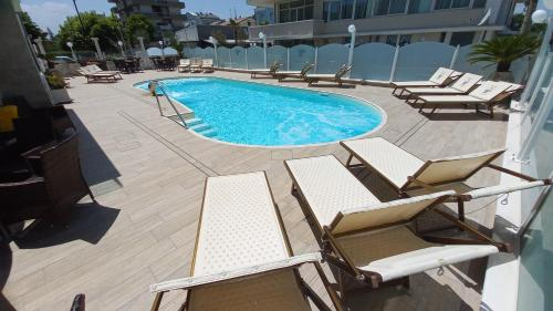 The swimming pool at or near Hotel Caesar Paladium