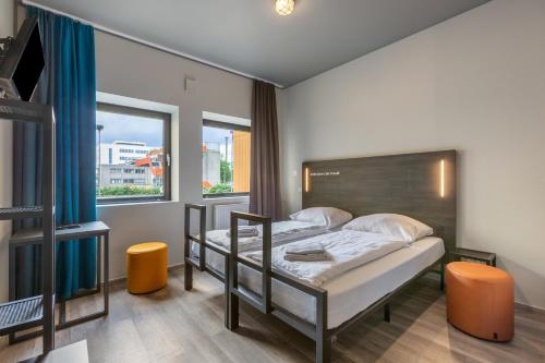 A bed or beds in a room at a&o Amsterdam Zuidoost