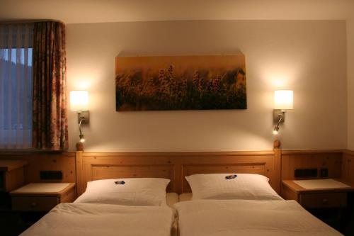 Ein Bett oder Betten in einem Zimmer der Unterkunft Landhaus Gnacke