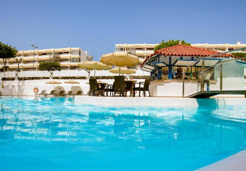 Het zwembad bij of vlak bij Rey Carlos