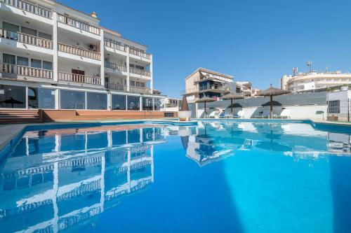 The swimming pool at or near Orange Colom - Seaside Apartments