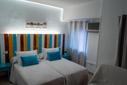 Cama o camas de una habitación en Rincón Extremeño