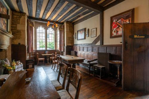 A restaurant or other place to eat at The George Inn & Plaine