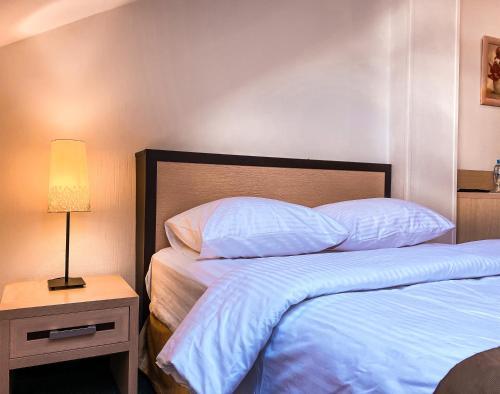 Cama o camas de una habitación en Минима Китай-Город