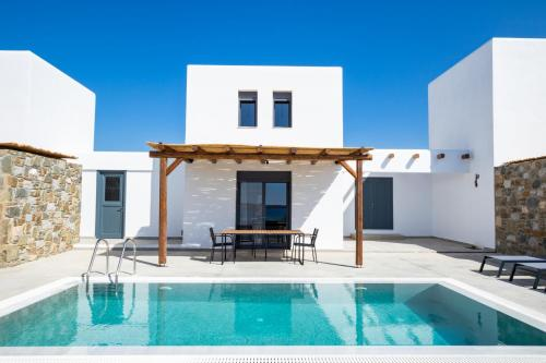 The swimming pool at or near Cato Agro 3, Seafront Villa with Private Pool