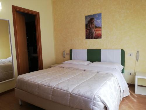 A bed or beds in a room at Albergo Roma