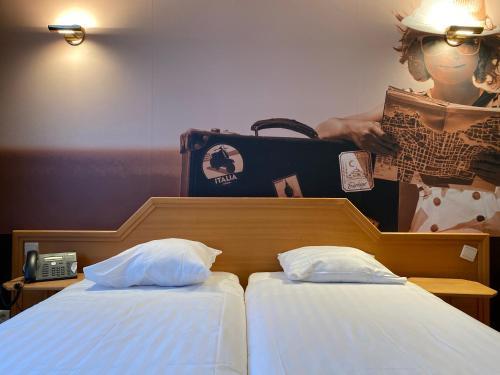 Ein Bett oder Betten in einem Zimmer der Unterkunft Liberty