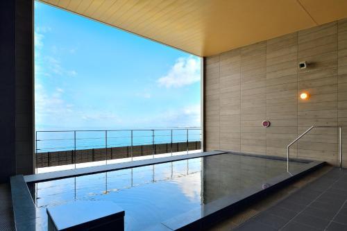 The swimming pool at or close to Henn na Hotel Kansai Airport