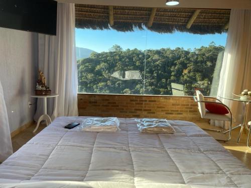 Cama ou camas em um quarto em Pousada R.N.C. Nosso Paraíso