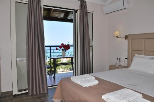 A bed or beds in a room at Dina's Paradise