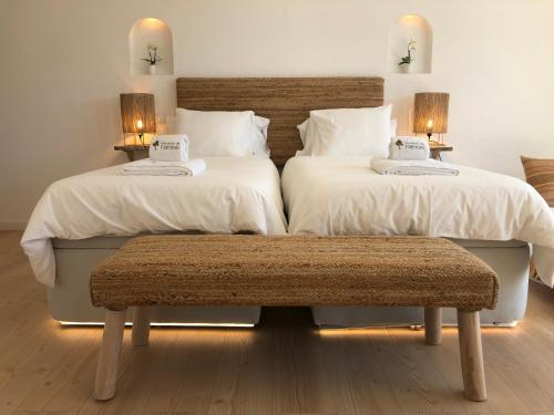 A bed or beds in a room at Herdade Do Freixial - Turismo Rural