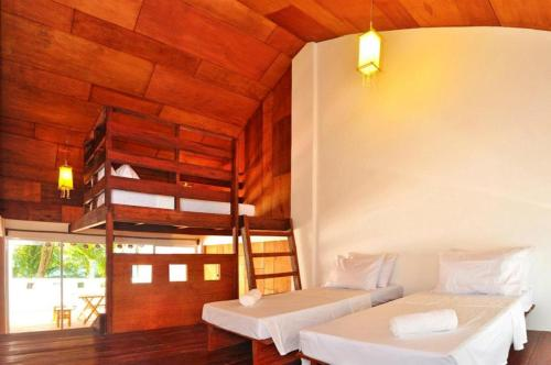 A bunk bed or bunk beds in a room at Boracay Coco Huts