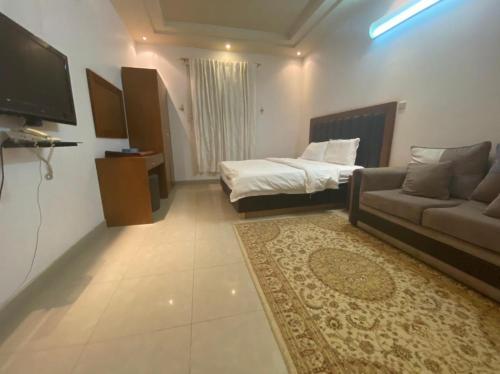 Cama ou camas em um quarto em Arkan Dareen