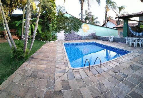 The swimming pool at or near Da Orla Pampulha Hostel