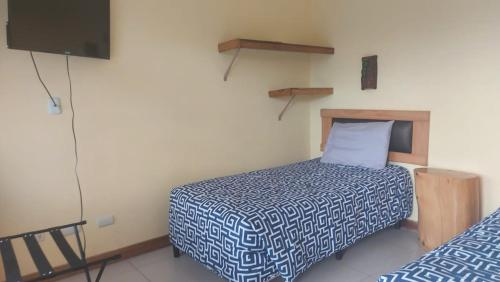 A bed or beds in a room at Paraiso Orocay Lodge