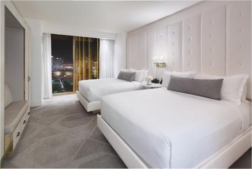 A bed or beds in a room at Delano Las Vegas at Mandalay Bay