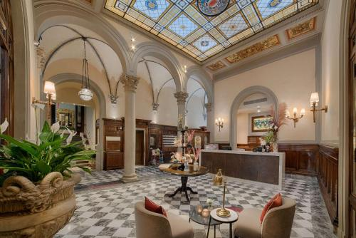 A restaurant or other place to eat at NH Collection Firenze Porta Rossa