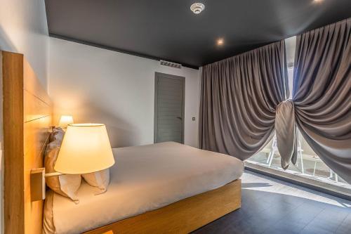 Cama o camas de una habitación en ONOMO Hotel Rabat Medina