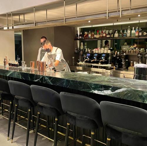 The lounge or bar area at Arcadion Hotel